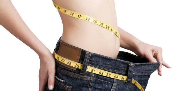 Slim woman with tape measure